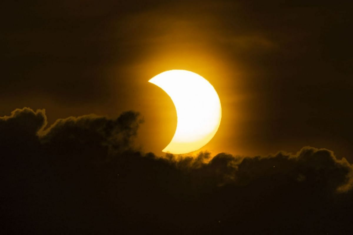 A partial solar eclipse rises New York, New York, USA, on June 10, 2021.