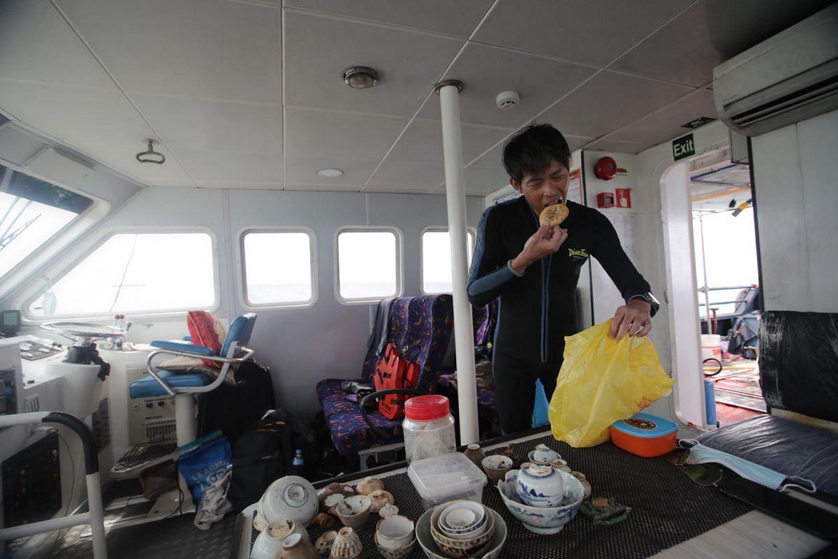 Diver Jason Khoo refuelling with a hum chim peng, a savoury dough fritter.