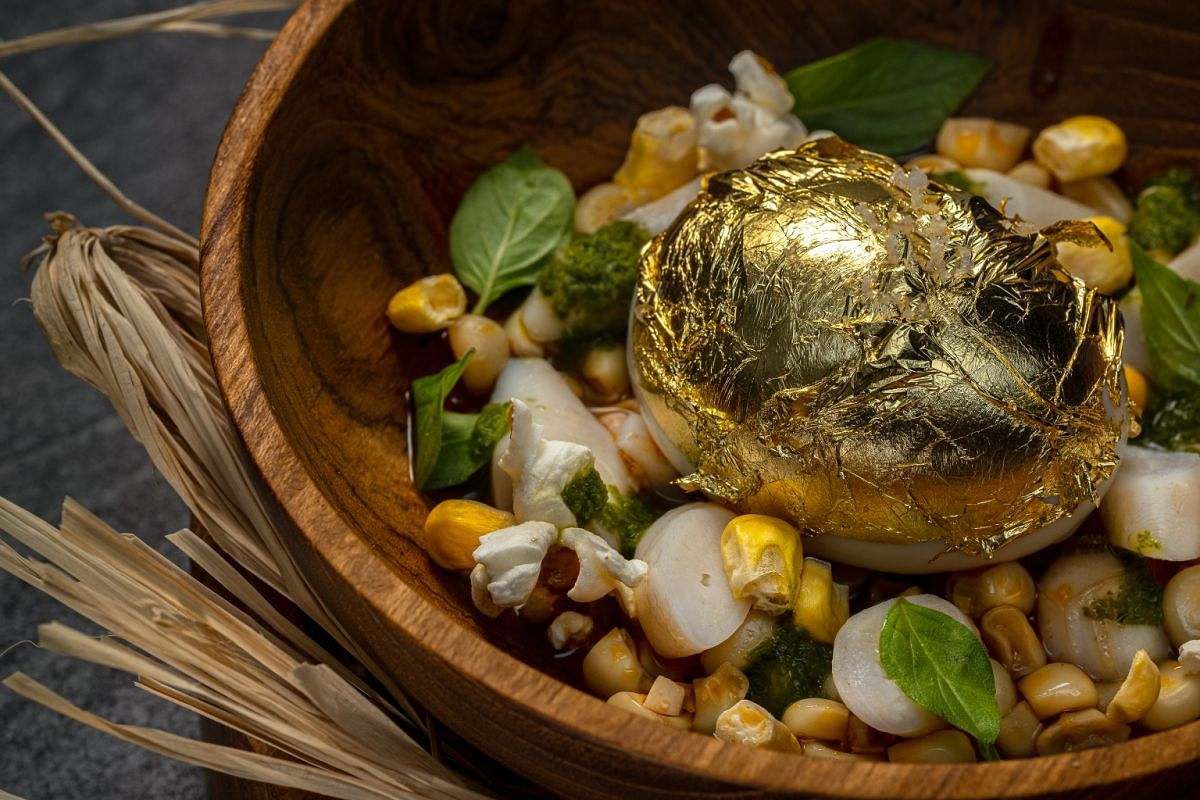 Casa Restaurant by Remy Lefebvre's Perfect Egg dish includes charcoal-cooked razor clams and corn.
