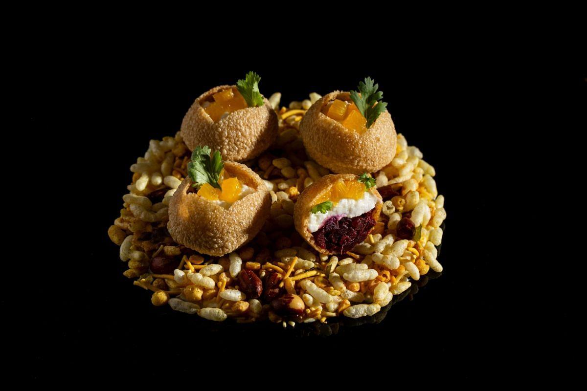 Firangi Superstar's Cali Puri with beetroot masala, goat's cheese and orange pani.