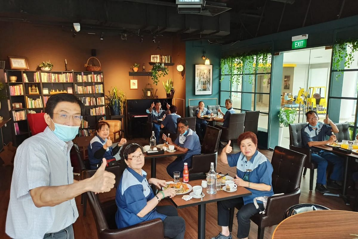 Dr Chee Soon Juan treated the cleaning staff of Rochester Mall to lunch at his new cafe Orange & Teal last Thursday, a day before the cafe opened to the public.