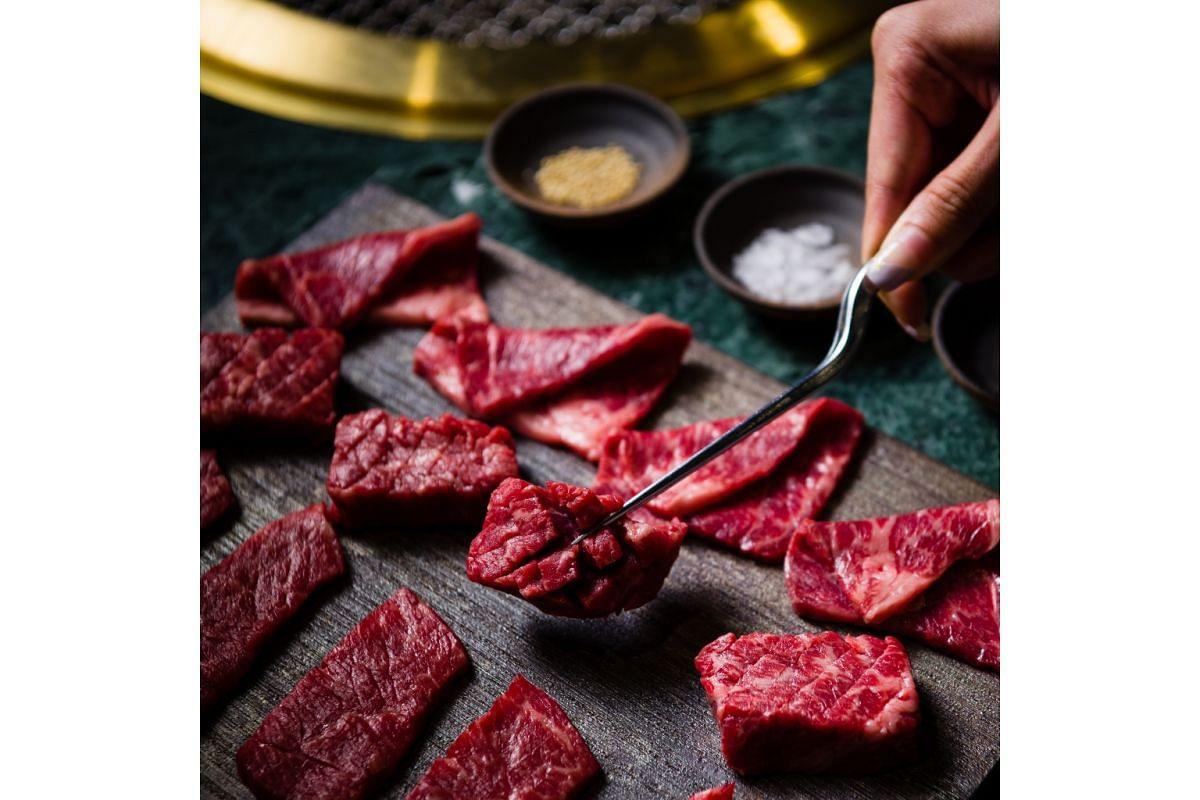Yen Social's Butcher Platter with four special cuts – thick cut karubi, chuck eye roll, chuck short ribs and Australian wagyu ribeye.