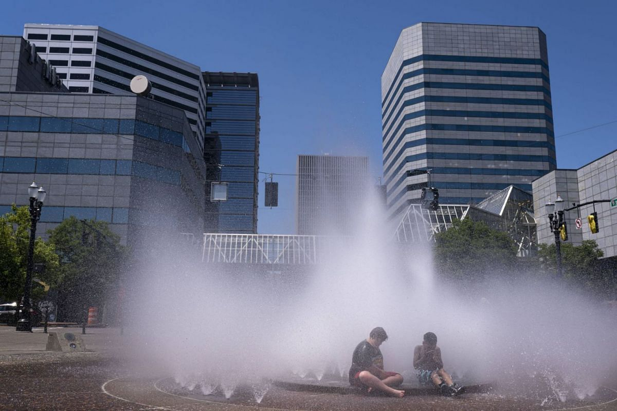 Kids play in the Salmon Springs Fountain on June 27, 2021 in Portland, Oregon. Record breaking temperatures lingered over the Northwest during a historic heatwave this weekend.