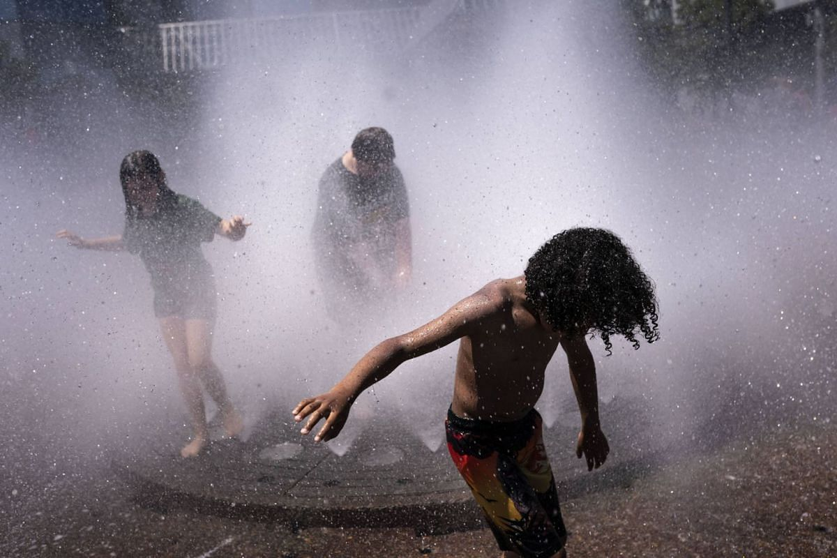Kids enjoy themselves in the Salmon Springs Fountain on June 27, 2021 in Portland, Oregon.