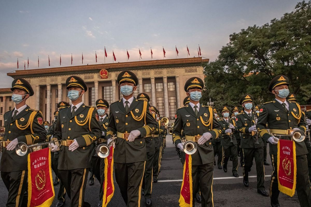 Members of the Chinese military orchestra march in front of The Great Hall of the People before a celebration at Tiananmen Square marking the 100th founding anniversary of the Chinese Communist Party, in Beijing, China, July 1, 2021.