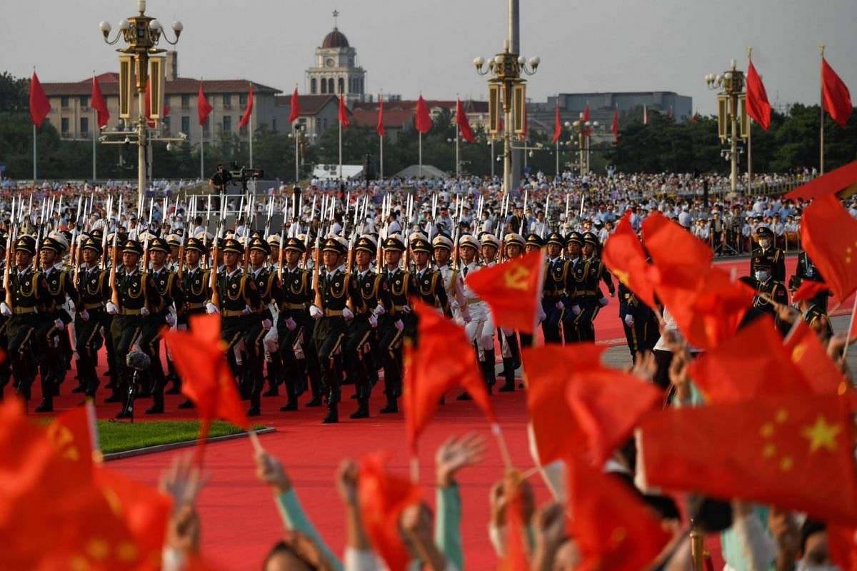 Chinese honour guards prepare for celebrations in Beijing on July 1, 2021, to mark the 100th anniversary of the founding of the Communist Party of China.