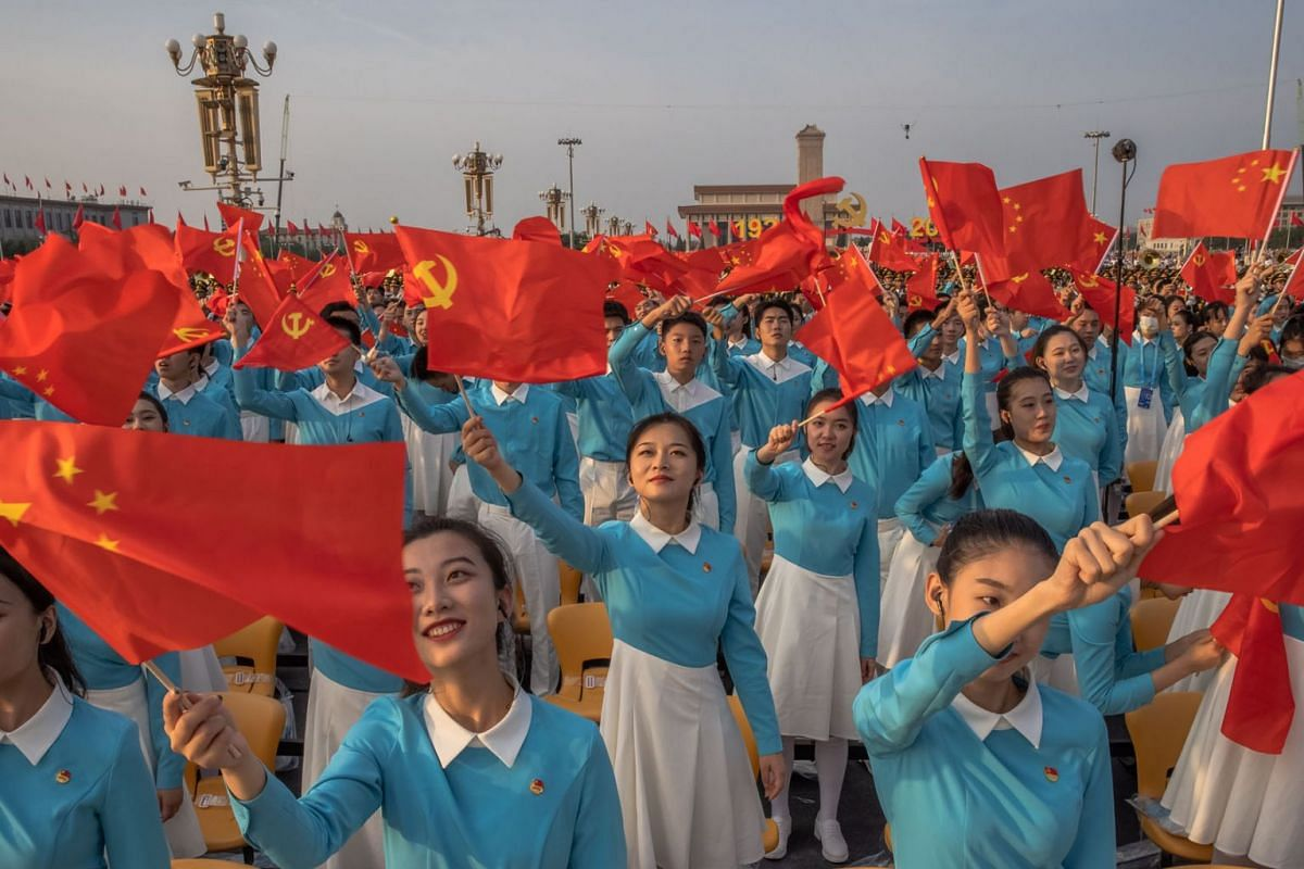 Participants rehearse before a celebration at Tiananmen Square marking the 100th founding anniversary of the Chinese Communist Party, in Beijing, China, July 1, 2021.