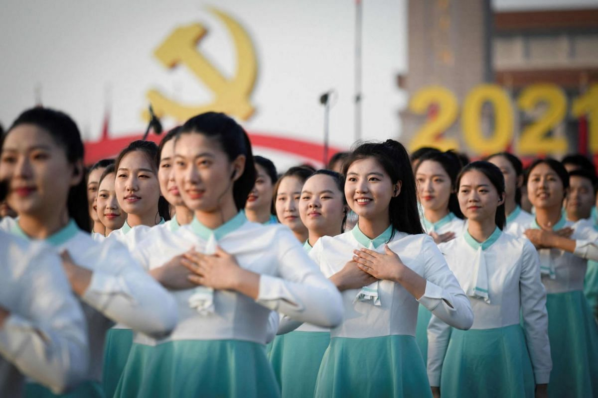 Attendees sing during a rehearsal before the celebrations marking the 100th anniversary of the founding of the Communist Party of China in Beijing on July 1, 2021.