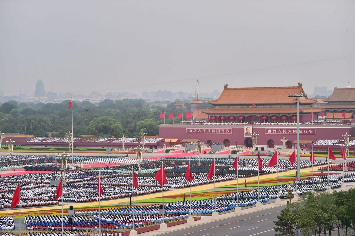 A handout photo made available by Xinhua News Agency shows a general view of the celebration marking the 100th founding anniversary of the Chinese Communist Party at Tiananmen Square in Beijing, China, July 1, 2021.