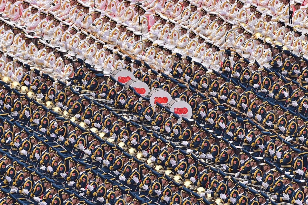 A handout photo made available by Xinhua News Agency shows military band members marching during a celebration marking the 100th founding anniversary of the Chinese Communist Party, in Beijing, China, July 1, 2021.