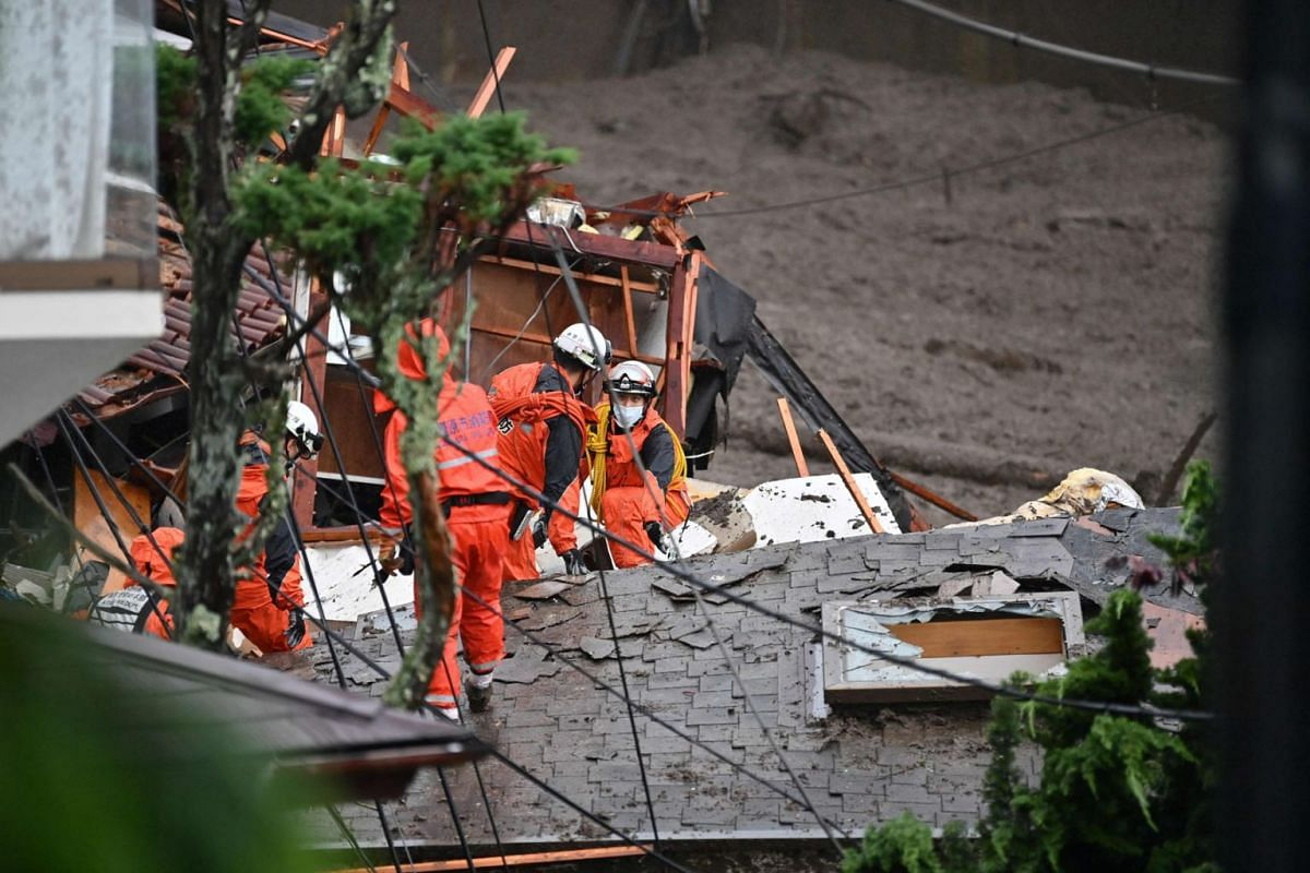 Firefighters search for survivors at the scene of a landslide following days of heavy rain in Atami in Shizuoka Prefecture on July 4, 2021.