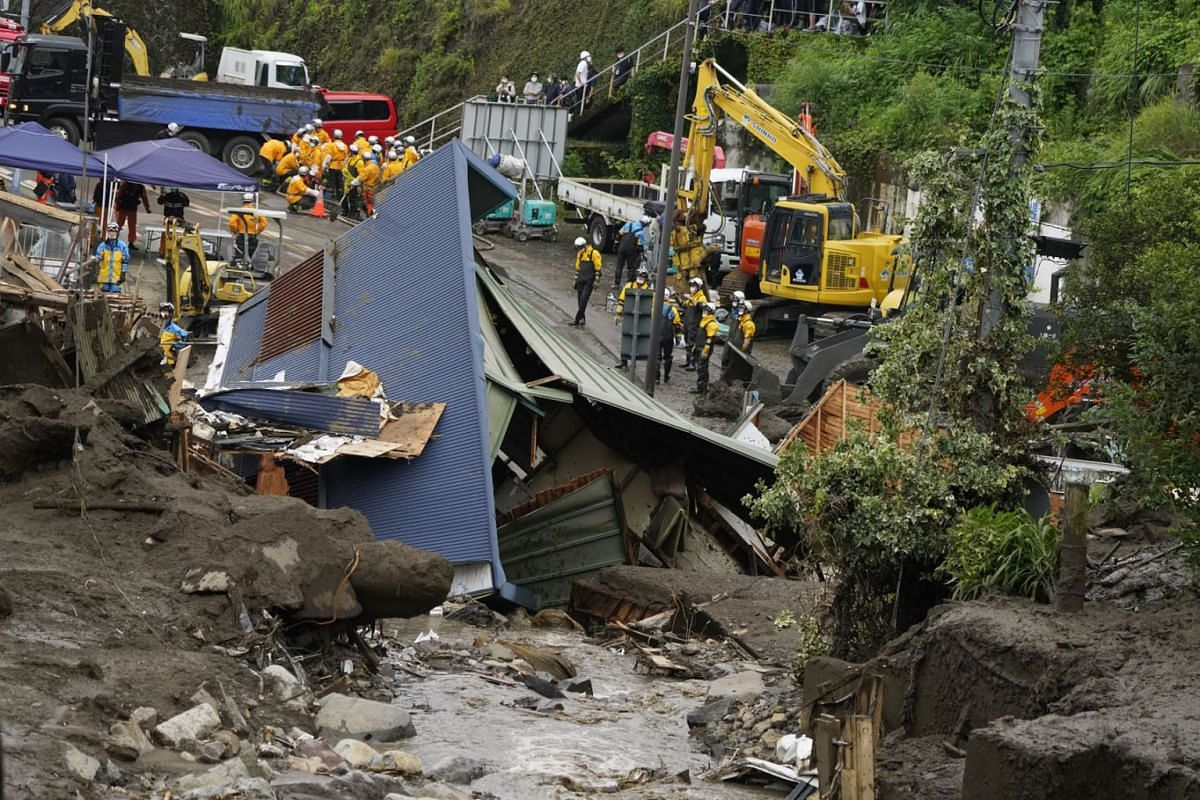 Rescue workers are searching for missing people on the mudslide triggered by torrential rain at hot-spring resort area Izusan in Atami, Shizuoka Prefecture, central Japan, July 5, 2021.