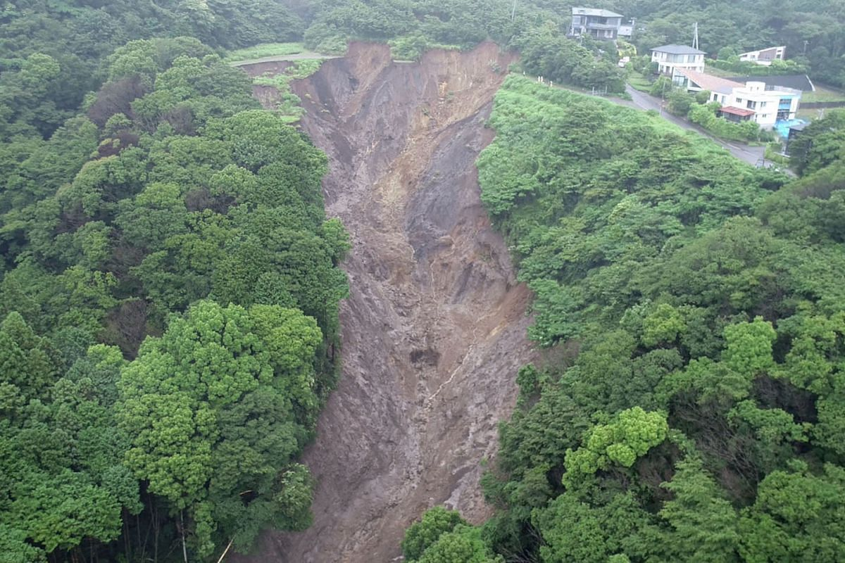 This grab taken on July 4, 2021, from handout video released by Shizuoka Prefecture and received via Jiji Press on July 5 shows an aerial view of the collapse site in Atami City, Shizuoka Prefecture, which was the starting point of a landslide which