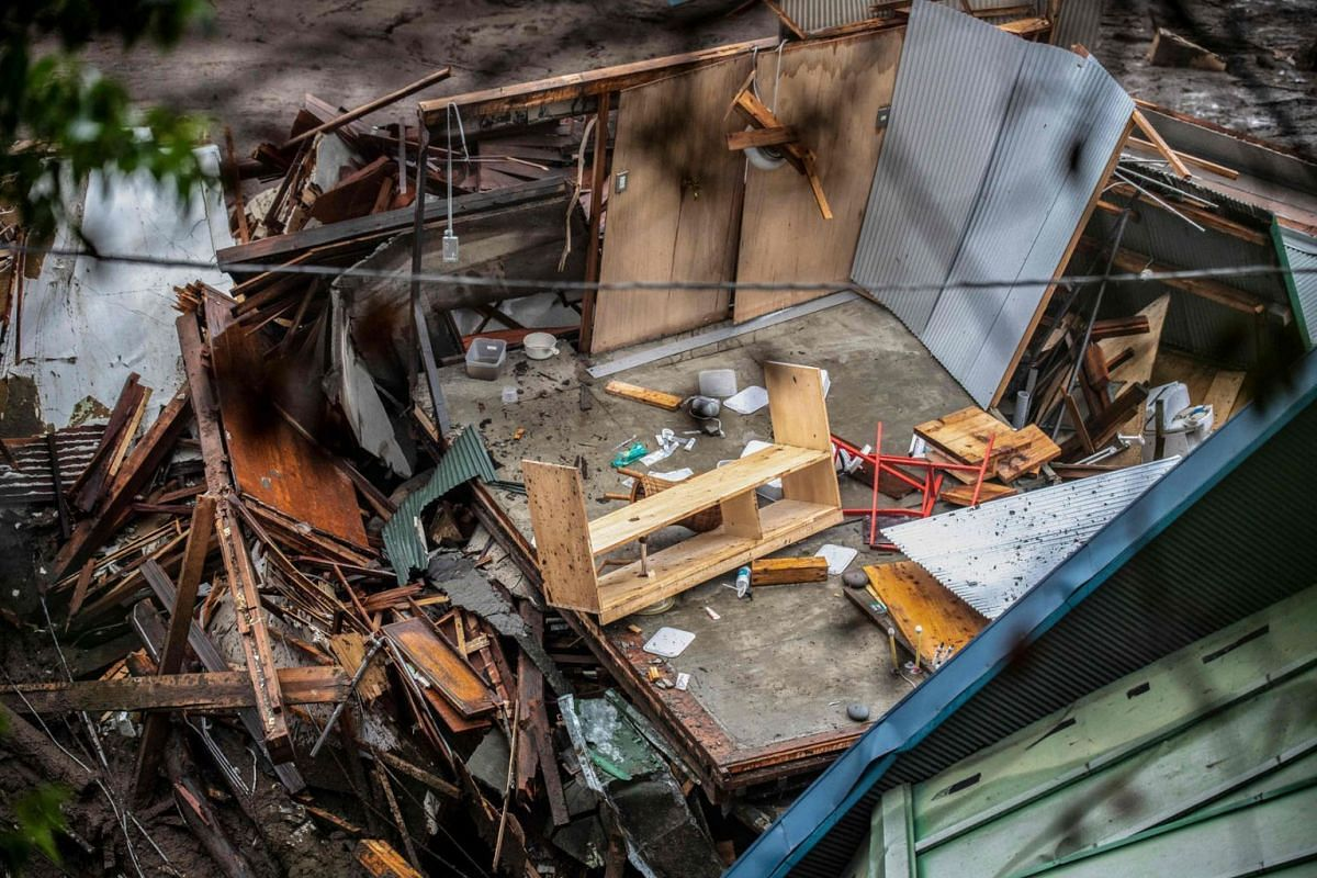 This picture shows items in a destroyed building after a landslide following days of heavy rain in Atami in Shizuoka Prefecture on July 4, 2021.