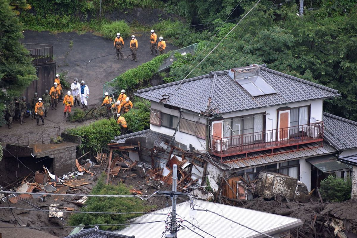 Rescue workers are searching for missing people after a mudslide, triggered by torrential rain, hit the hot-spring resort area Izusan, in Atami, Shizuoka Prefecture, central Japan,  July 4, 2021.