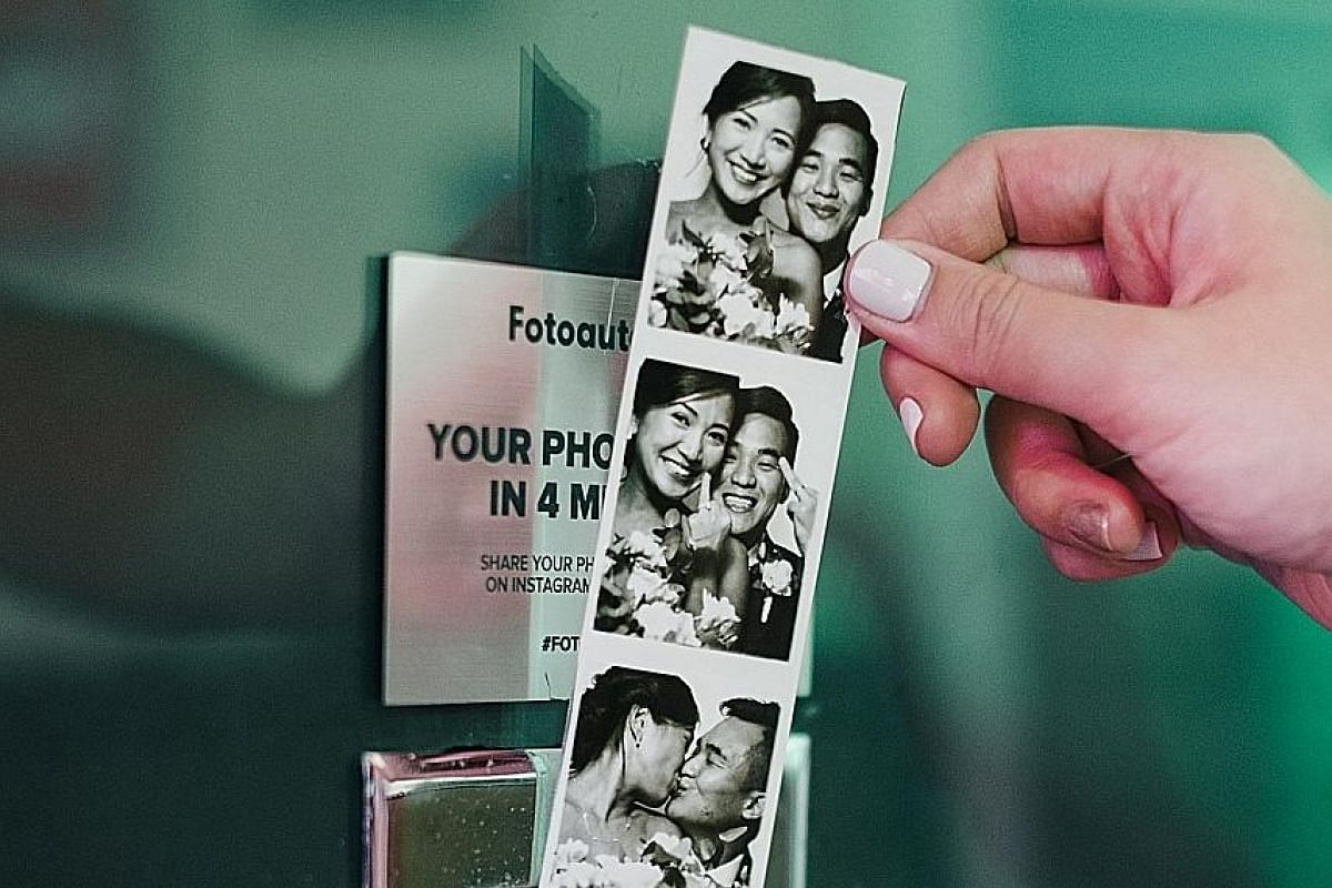 Ms Thea Tan and Mr Afiq Safwan Adly (both right) brought in a discarded analogue photo booth from San Diego last year and now lease it out at The Projector. Novelty meets nostalgia with these black-and-white photos taken at Fotoautomat's vintage anal