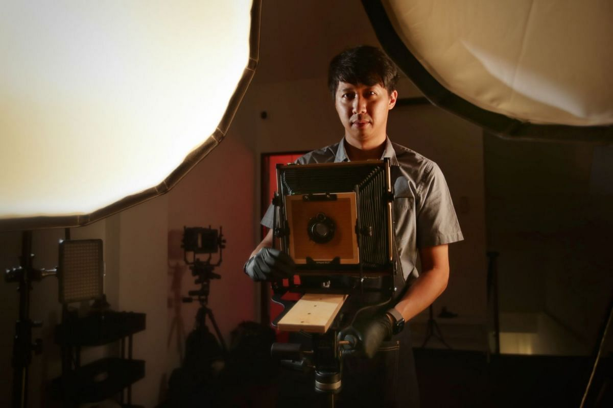 Hoppity Studio founder Ripple Sim (above, with her husband Jason Soo and daughter Miley) created a set that mimicked a mama shop (top). At Hip Xiong Photo Studio, photographer Ryan Lee (left) captures portraits using wet plate tintype (far left), a t