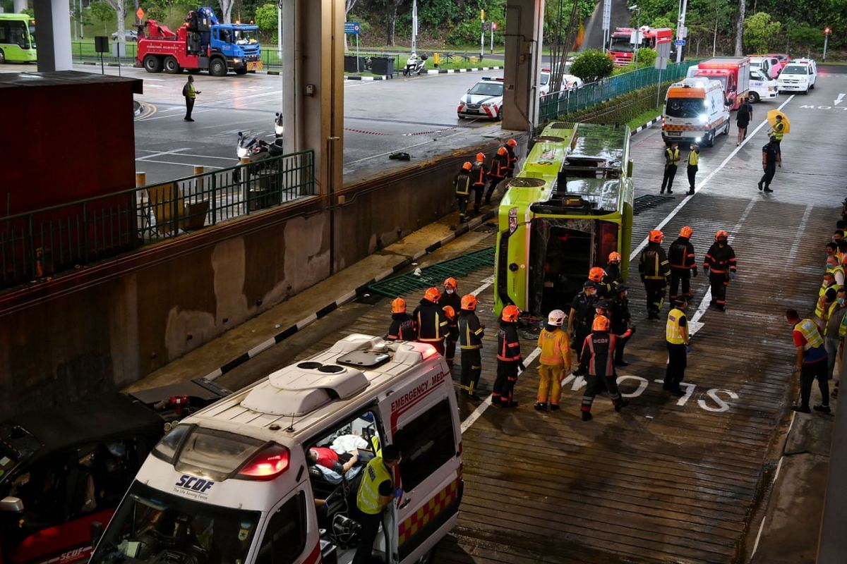 A passenger being treated in the ambulance at the Bukit Batok bus interchange on 11 July 2021. Two buses were involved in an accident at Bukit Batok Bus Interchange on Sunday afternoon, leaving one on its side.