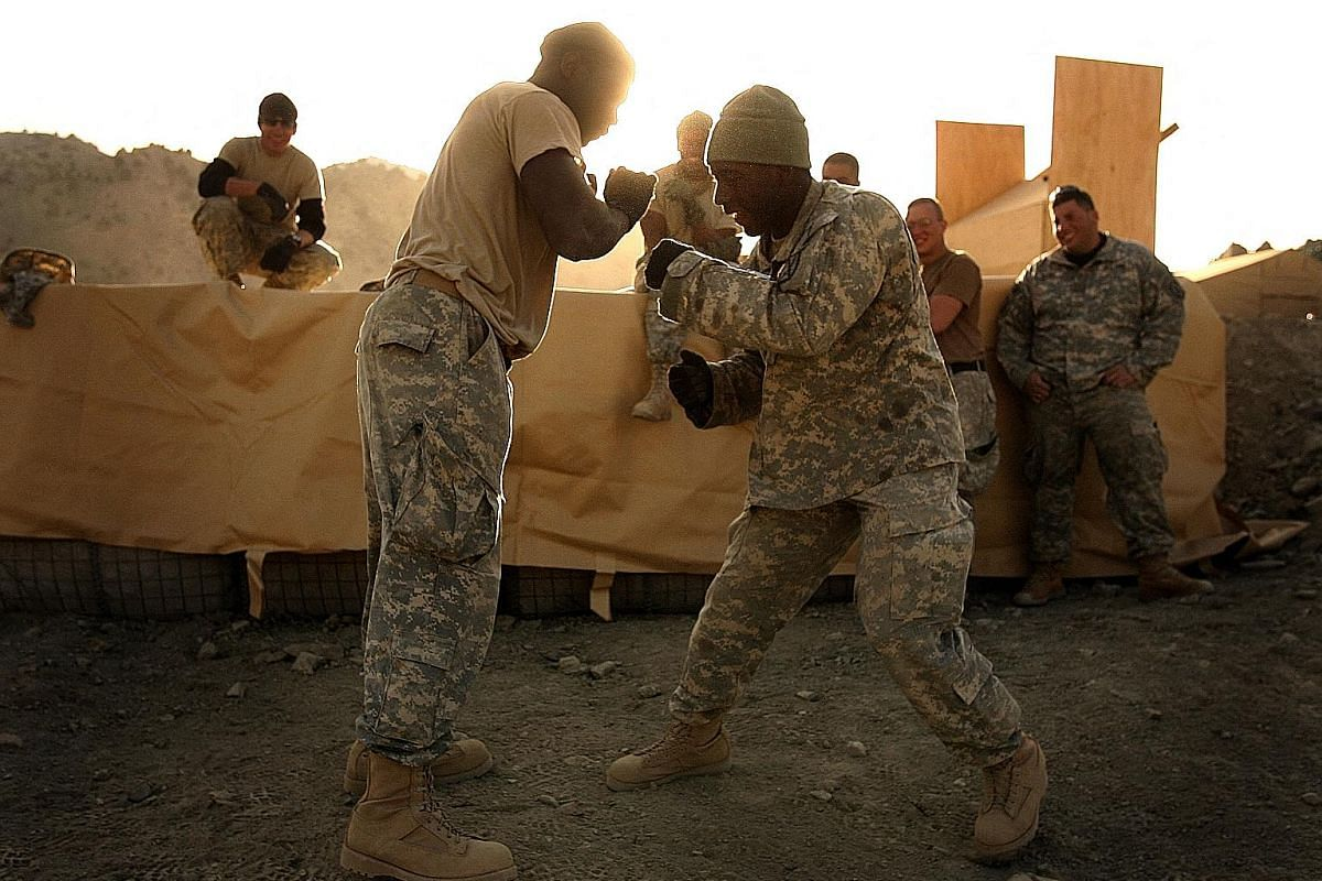 Nov 26, 2006: US soldiers from the 3rd Brigade Special Troops Battalion, 10th Mountain Division, practise boxing techniques at Firebase Wilderness, a joint US-Afghan outpost, in Paktia province. Nov 11, 2009: A US Army soldier and an Afghan National