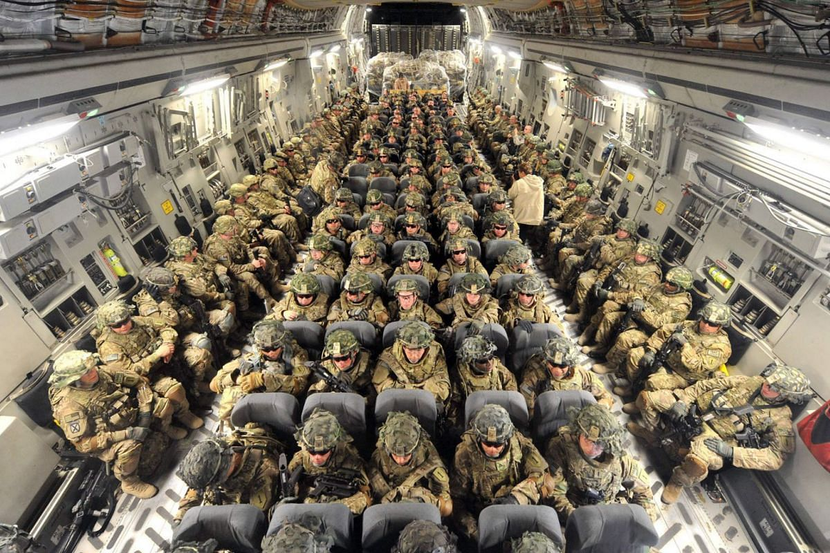 US Soldiers from the 234th Infantry Division, Fort Riley, Kansas, are seen inside of a plane to Afghanistan from the US transit center Manas 30kms from Bishkek, April 15, 2011.