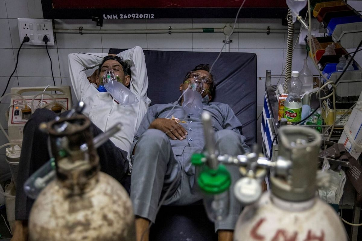 Patients suffering from Covid-19 sharing a bed at the casualty ward in Lok Nayak Jai Prakash hospital, amid the spread of the disease in New Delhi, India, on April 15, 2021.