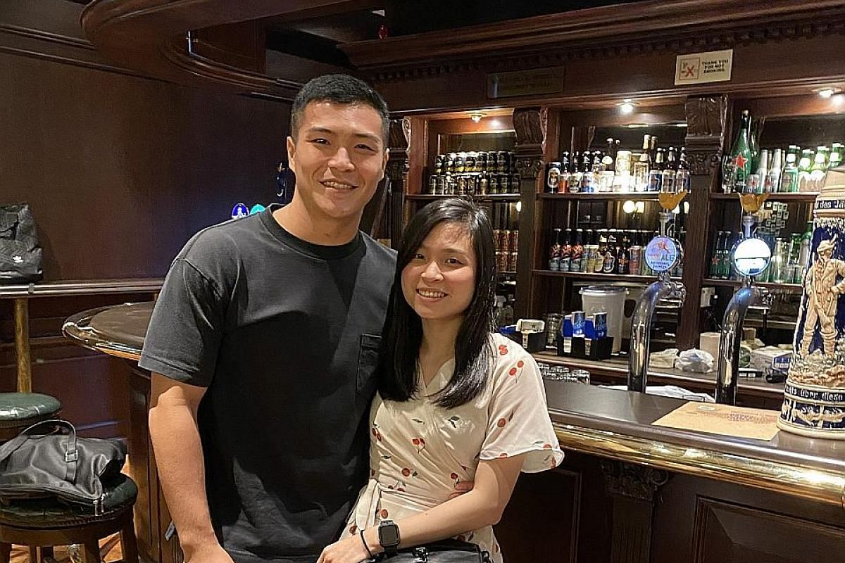 Mr Nigel Sim, 26, with his girlfriend Ms Sally Tan, 26. The couple met on Tinder earlier this year.