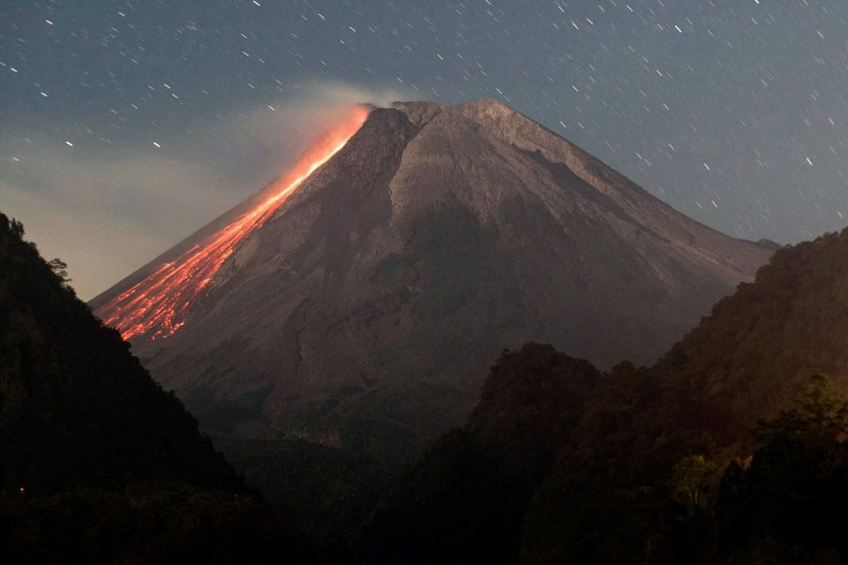 Lava flows down Mount Merapi, Indonesia's most active volcano, as seen from Sleman in Yogyakarta on July 18, 2021.