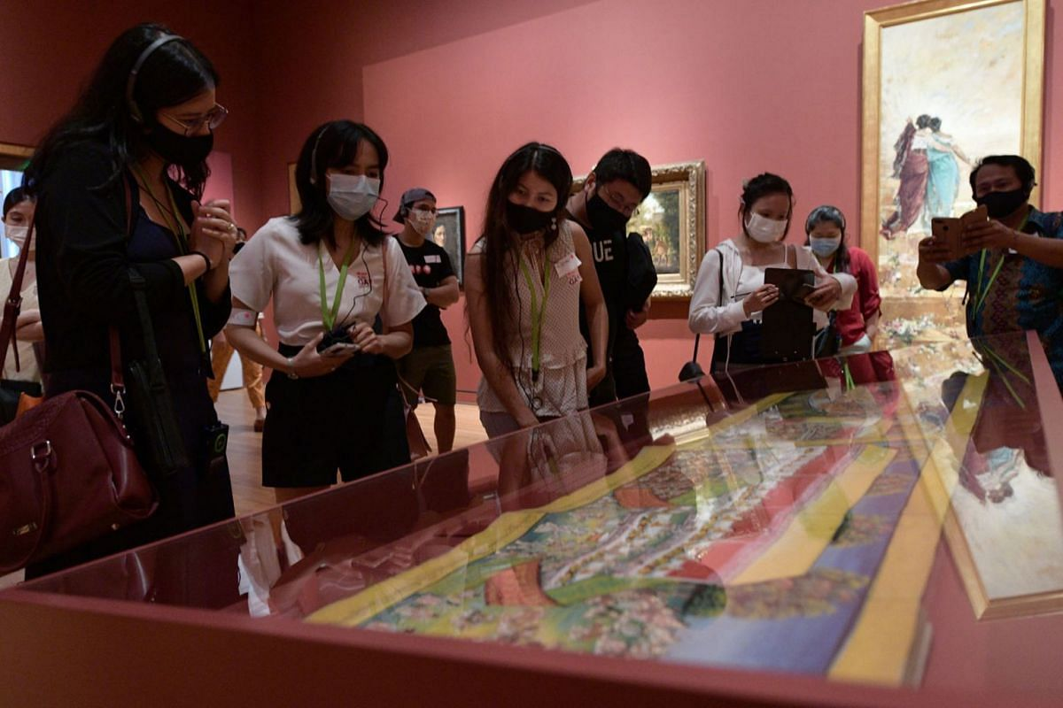 A group of people from the Myanmar community in Singapore went on a tour of artworks by Myanmar artists at National Gallery Singapore and also engaged in a tote bag printing workshop on July 18, 2021. The tour, which is part of the gallery's Art For