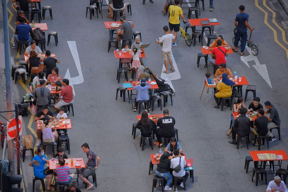 Diners of up to 5 are seen outside Lau Pat Sat on July 18, 2021, a day before the new rules on dining kick in.