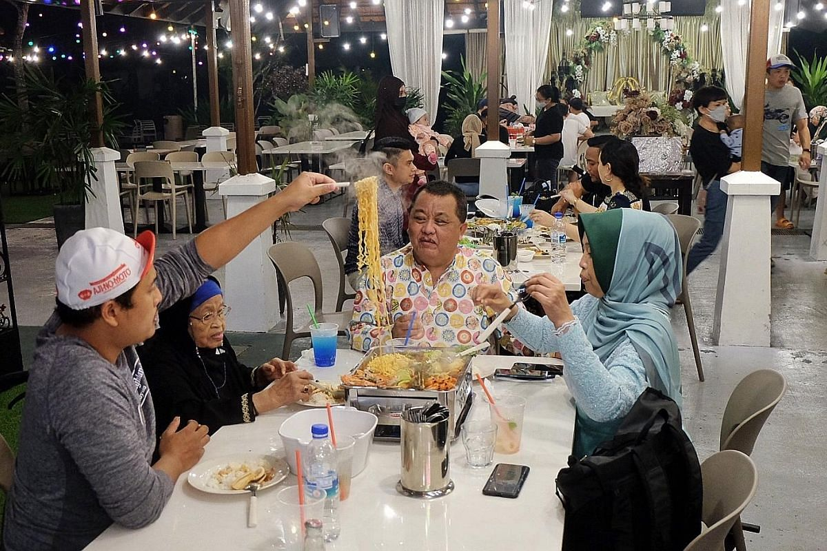 Diners tucking in during dinner last Thursday at 555 Halal Thai, a restaurant that is located within Gallop Kranji Farm Resort. An elderly woman having a light-hearted moment while out for a meal with her family at a food court in Clementi Mall last