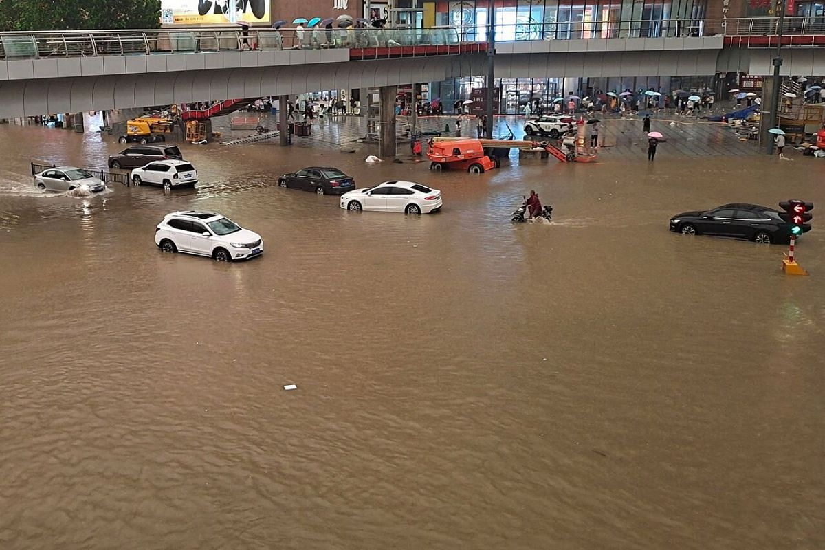 Vehicles driving through flood waters after heavy rains in Zhengzhou, a city of more than 12 million on the banks of the Yellow River.