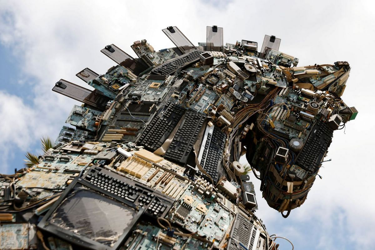 """The head of a """"Cyber Horse"""", made from discarded electronic bits, is seen on display near the entrance to the Cyber Week conference at Tel Aviv University, Israel, July 21, 2021."""
