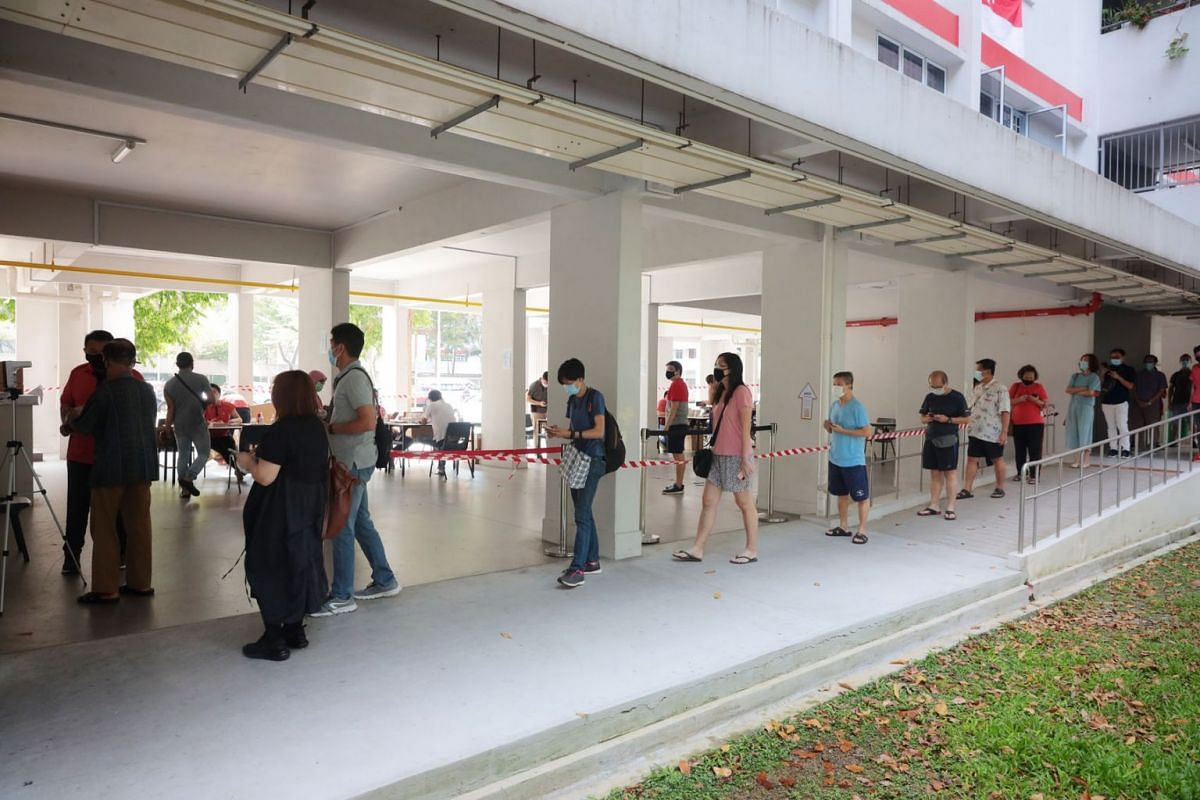 People queueing for antigen rapid test kits at Block 5 Haig Road on July 21, 2021. The self-test kits are for individuals who had visited four markets and food centres in the past 14 days – Cheng San Market and Cooked Food Centre, Chong Boon Market