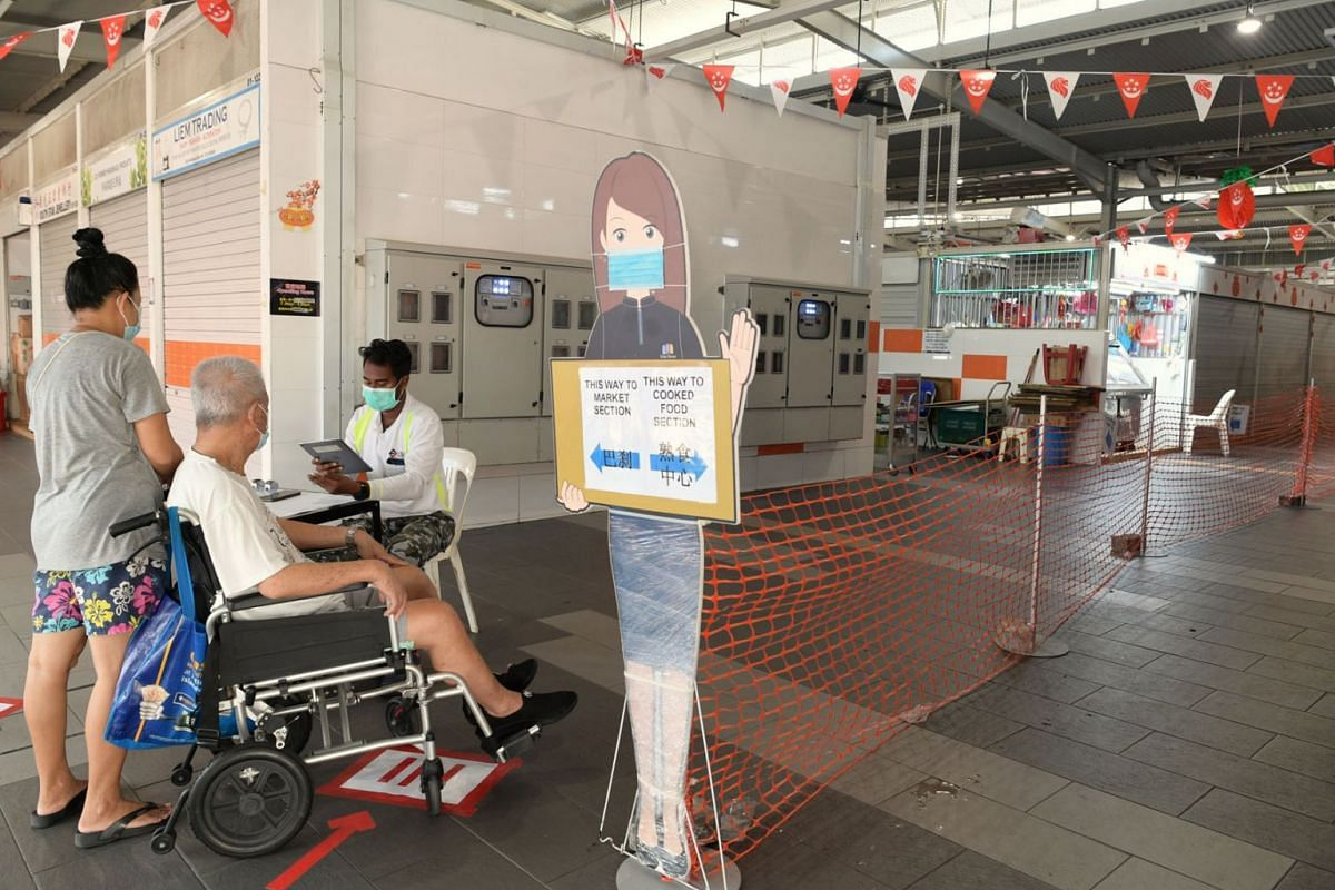Safe-distancing measures at Geylang Bahru Market and Food Centre on July 22, 2021.