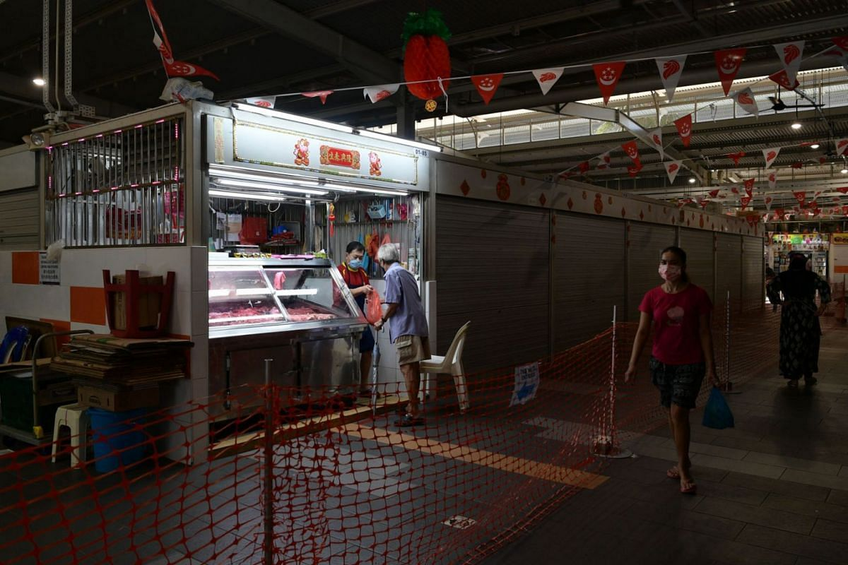 A pork stall, one of very few stalls open at Geylang Bahru Market and Food Centre, is seen on July 22, 2021.