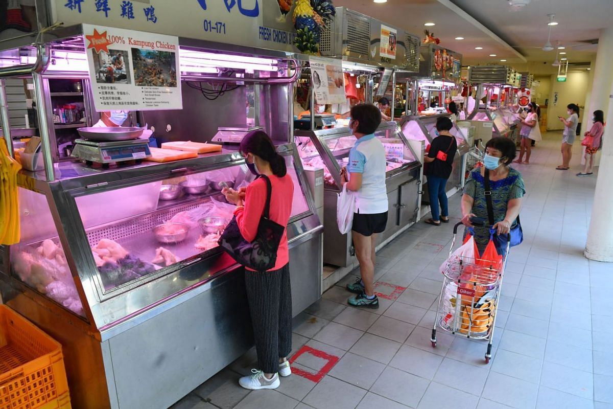 A visibly thinner crowd at Tiong Bahru Market is seen on July 22, 2021.