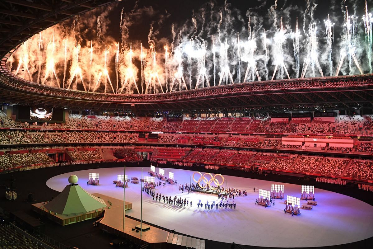 Fireworks over Olympic Stadium as dancers perform during the opening ceremony.
