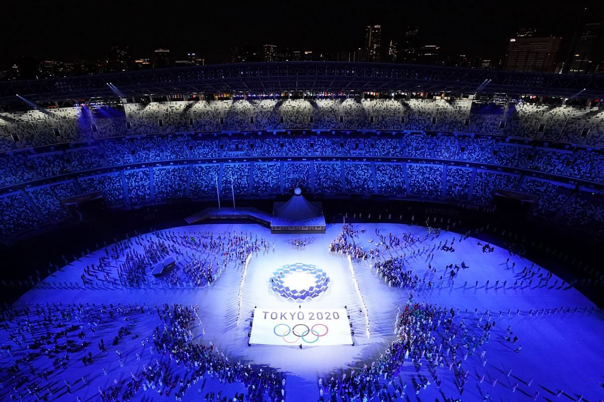 The Tokyo 2020 Olympics flag and logo are seen during the opening ceremony.