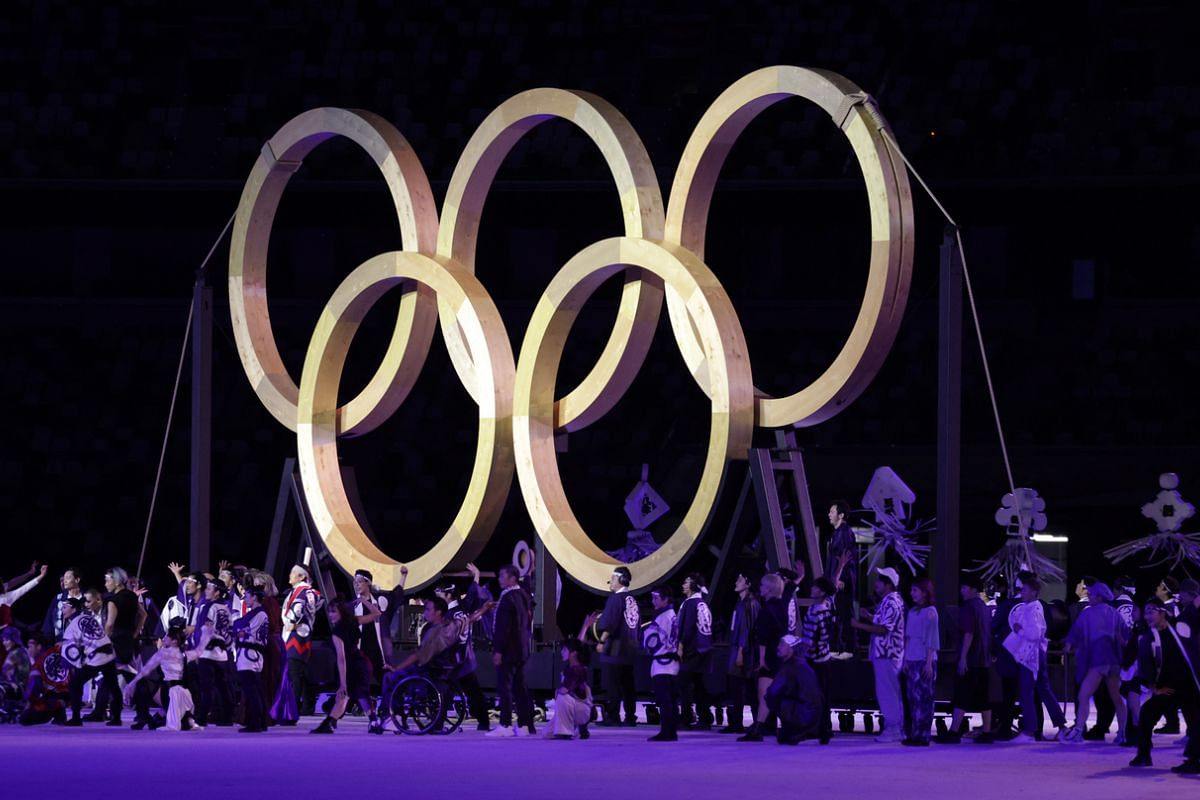 Performers seen next to the Olympic rings during the opening ceremony.