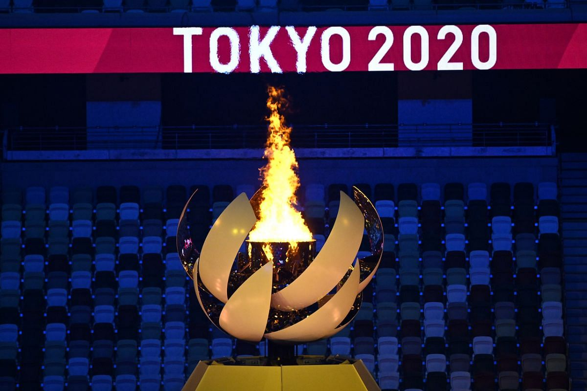 The Olympic torch is seen during the opening ceremony on July 23, 2021.