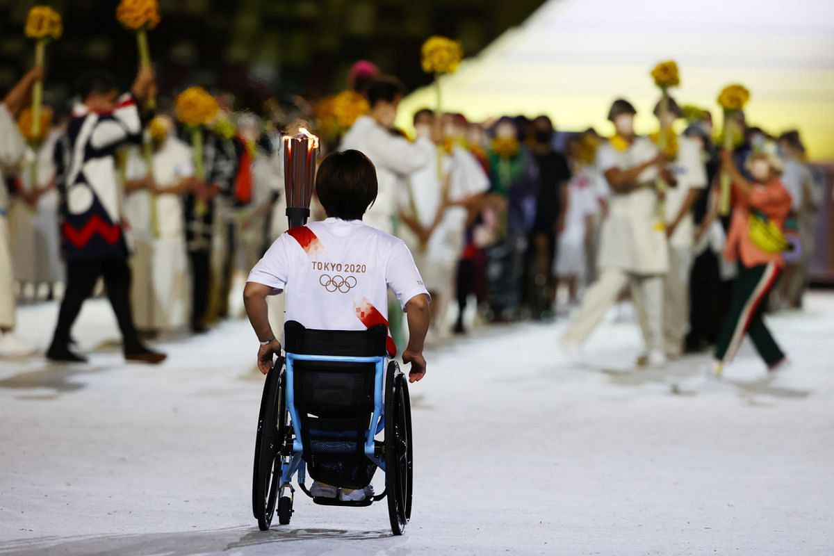 Japanese Paralympic athlete Tsuchida Wakako after holding the Olympic torch during the opening ceremony on July 23, 2021.