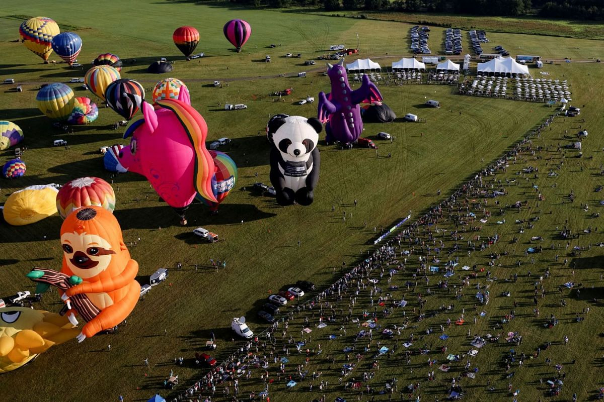 People enjoy a balloon ride during the New Jersey Lottery Festival of Ballooning in Readington, New Jersey, U.S., July 24, 2021.