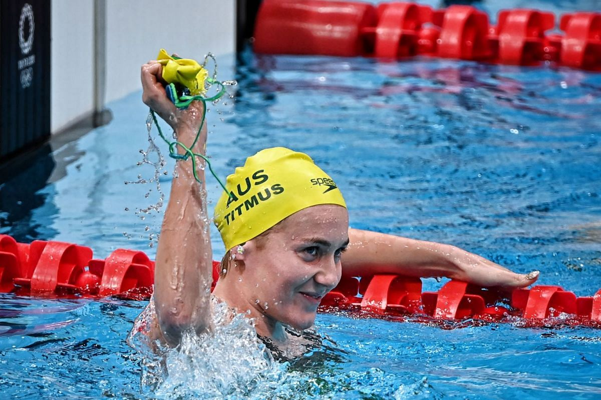 Australia's Ariarne Titmus wins the 400m freestyle final, beating rival US swimming great Katie Ledecky, to clinch the gold medal  during the Tokyo 2020 Olympic Games  at the Tokyo Aquatics Centre on July 26, 2021.