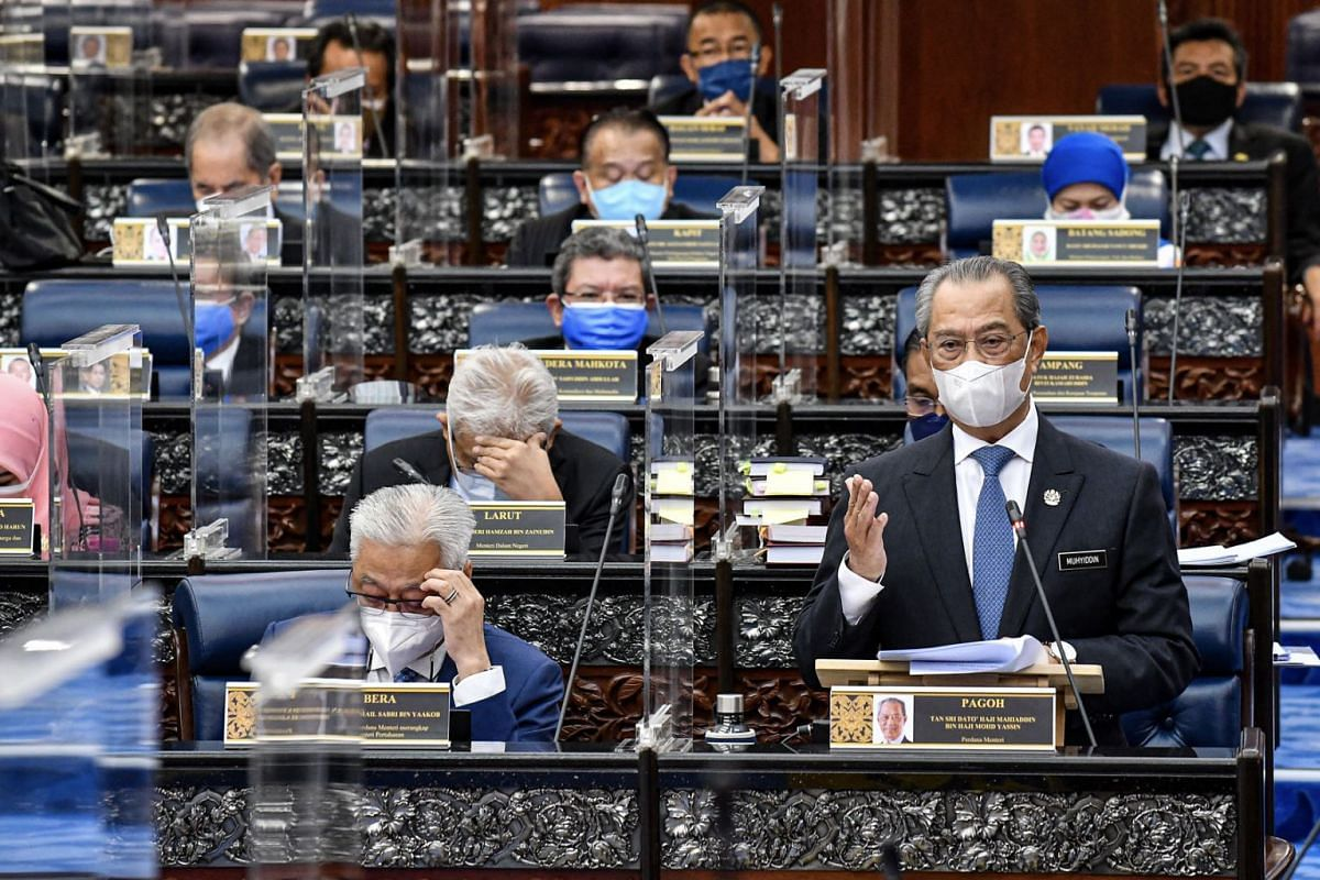 A handout photo made available by the Department of Information of Malaysia shows Malaysian Prime Minister Muhyiddin Yassin (R) speaking during a special five-day sitting at the Malaysian Houses of Parliament headquarters in Kuala Lumpur, Malaysia, o