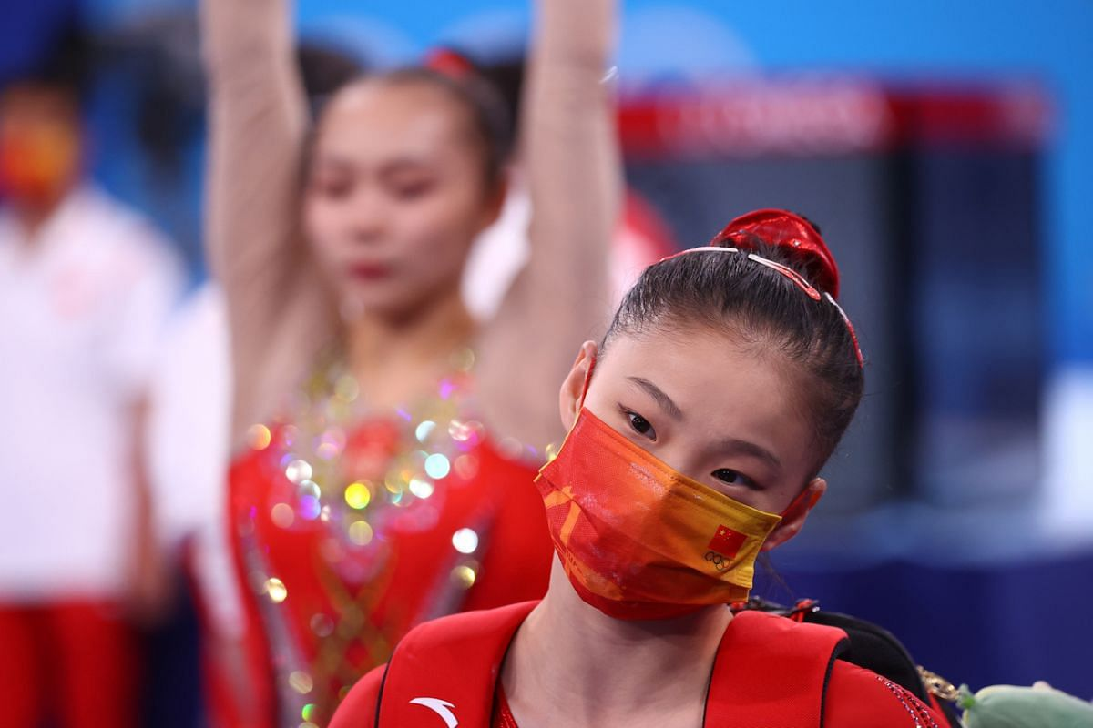 An artistic gymnast from China wears a protective face mask during training on July 22, 2021.