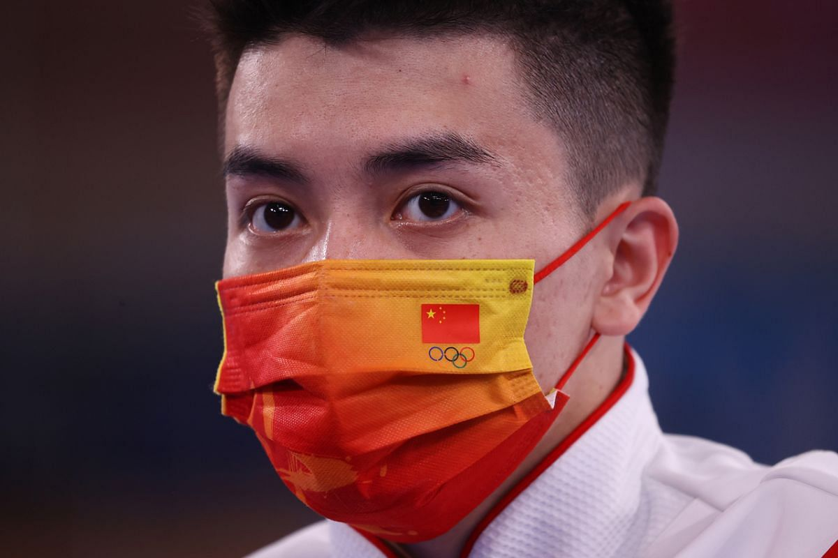 A Chinese gymnast wears a protective face mask during training on July 21, 2021.