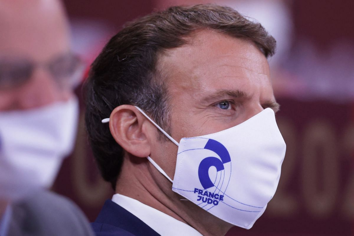French President Emmanuel Macron wearing a protective face mask while watching a judo match, on July 24, 2021.