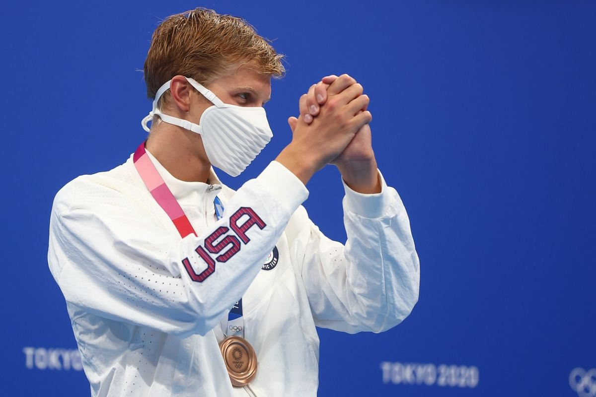US swimmer Kieran Smith wears a face mask on the podium on July 25, 2021.