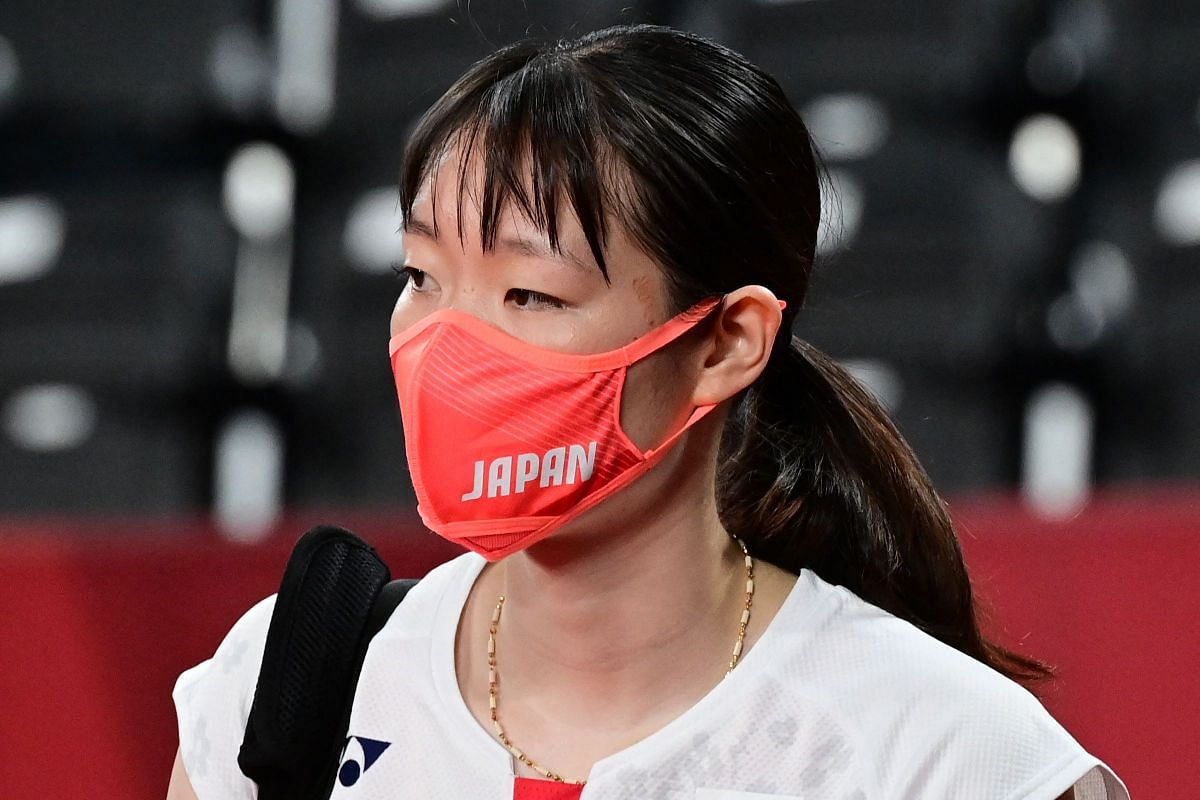 Japan's Mayu Matsumoto wears a face mask before her women's doubles badminton group stage match with partner Wakana Nagahara, in Tokyo, on July 24, 2021.