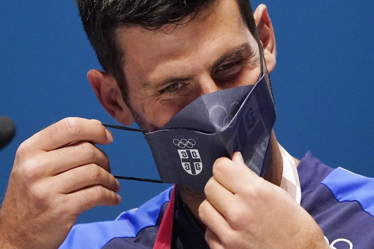 Serbian tennis player Novak Djokovic wears a face mask during a press conference in Tokyo, on July 22, 2021.